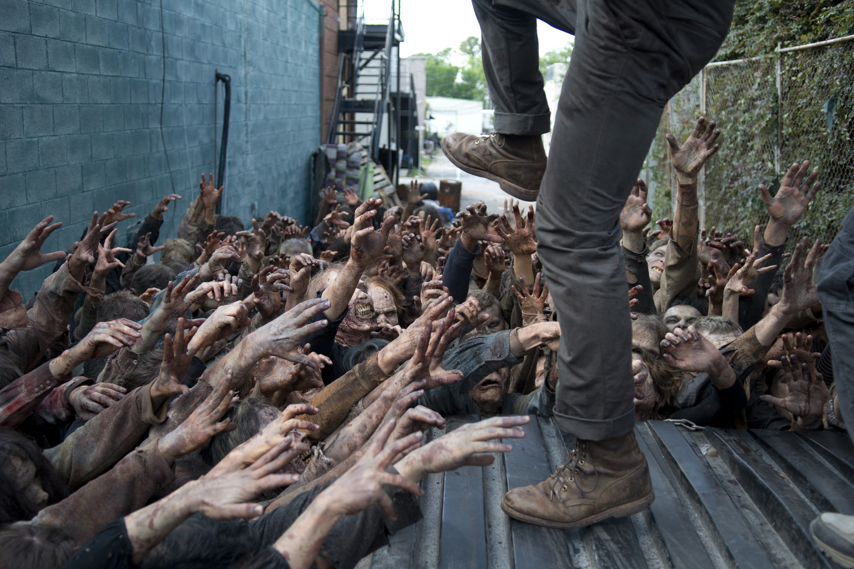 Walkers grab at glenn in the walking dead season 6.
